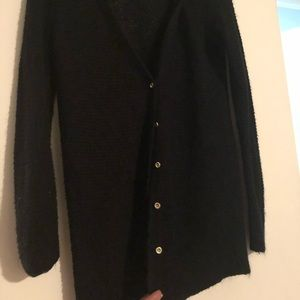Black sweater with gold buttons